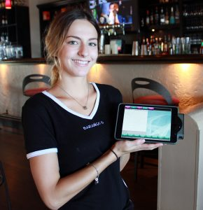 Barangas' server and owners' granddaughter Madison displays the iPad Mini ordering device that she says has made handling multiple tables much easier and faster.